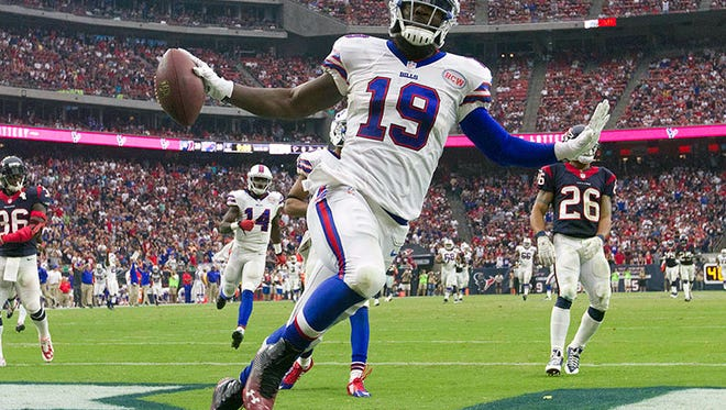Bills WR Mike Williams celebrates his touchdown catch during Sunday's game in Houston.