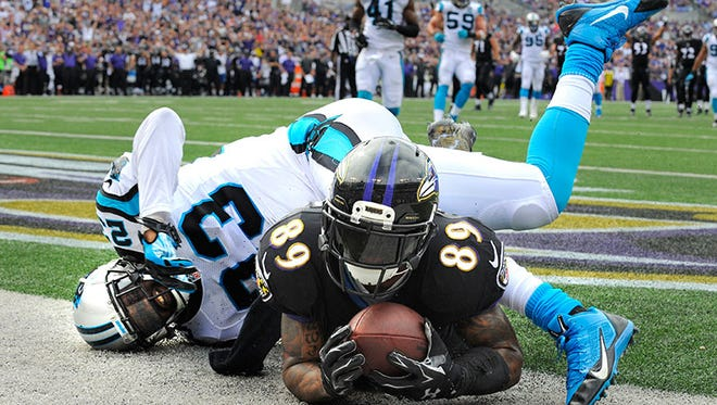 Ravens receiver Steve Smith catches a touchdown pass during Sunday's win over the Panthers.