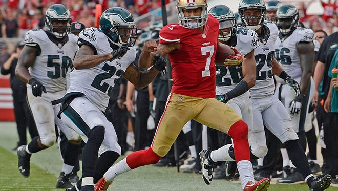 49ers QB Colin Kaepernick runs out of bounds in the win over the Eagles Sunday.