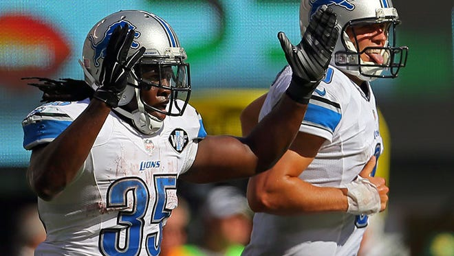 Lions RB Joique Bell and QB Matthew Stafford celebrate a touchdown.