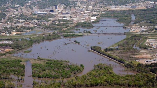 Floodwaters flow over the banks of the Pearl River near downtown Jackson on Wednesday. The river is expected to crest on Friday evening.