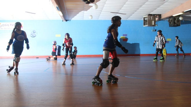 Photo of the Buckeye Beautyz junior roller derby team on Wednesday, Sept. 18, 2014, days before a scrimmage at Zoomers Skate Club that year. Zoomers Skate Club Owner Kandy Yarger worries the skating rink will not survive the coronavirus crisis.