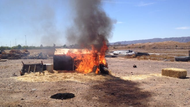 Phoenix firefighters set household items and brush ablaze at the Phoenix Fire Training Academy Tuesday morning to demonstrate the dangers of legal fireworks.