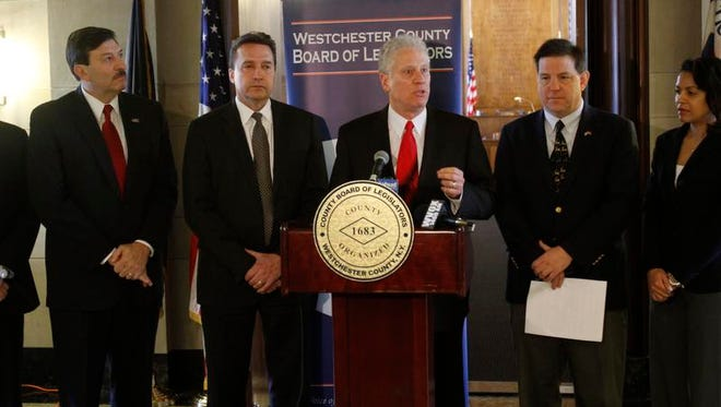 Board of Legislators Michael Kaplowitz, at podium, surrounded by members of a bipartisan coalition pictured in 2013 at a press conference announcing the board's new leadership structure.