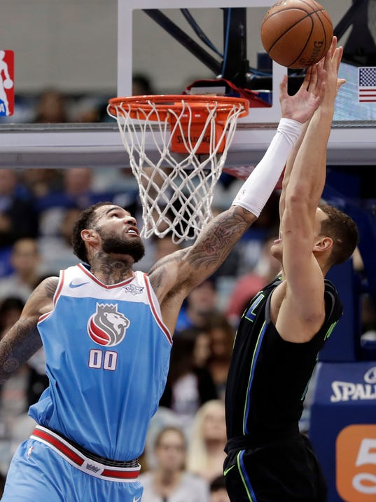 Sacramento Kings center Willie Cauley-Stein (00) disrupts a pass to Dallas Mavericks forward Dwight Powell (7) on an dunk attempt in the first half of an NBA basketball game Tuesday, Feb. 13, 2018, in Dallas. (AP Photo/Tony Gutierrez)