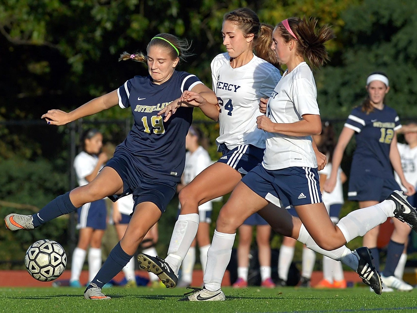 Pittsford Sutherland's Grace Allen, left, tries to control the ball while pressured by Mercy's Aileen Dalton, center, and Diana Colpoys.