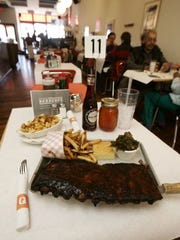 A full slab of ribs with corn bread and house-made