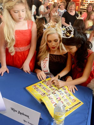 Miss Jackson Morgan Fitzgerald and her Iris Princesses Olivia Arnold and Jolee Morgan sign autographs for fans at the Miss Tennessee 2016 contestant meet-and-greet on Sunday.