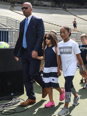 Penn State Nittany Lions head coach James Franklin walks the field with his daughters Shola and Addy before the start of the Penn State home opener against Kent State on Saturday, Sept. 3, 2016.