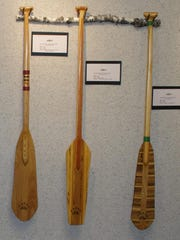 Wooden canoe paddles by Rudy Senarighi, whose works on exhibit through October at the Hope Church Art Alcoves Gallery.