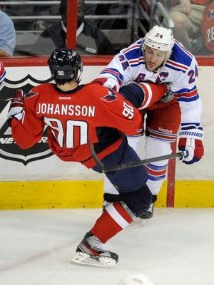 Washington Capitals center Marcus Johansson (90), of Sweden, tangles with New York Rangers right wing Ryan Callahan (24) during the first period of Game 4 of an NHL hockey Stanley Cup second-round playoff game in 2012.