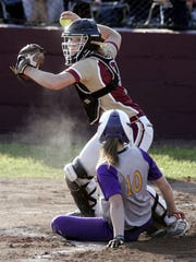Riverdale's catcher Sarah Higgins tags out Smyrna's Heather Hofferbert and tries to make a play on 3rd  during the 7-AAA District softball championship on Saturday  May 11, 2013, at Riverdale. Smyrna won the 7-AAA District softball championship with a score of 6 to 2.