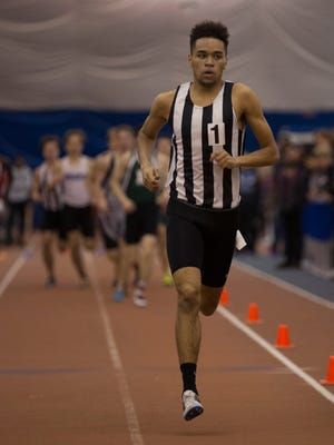 Old Bridge's Rey Rivera takes first in the Group IV 800 meter run at the NJSIAA Groups I and IV championships on Friday at the Bennett Center in Toms River.