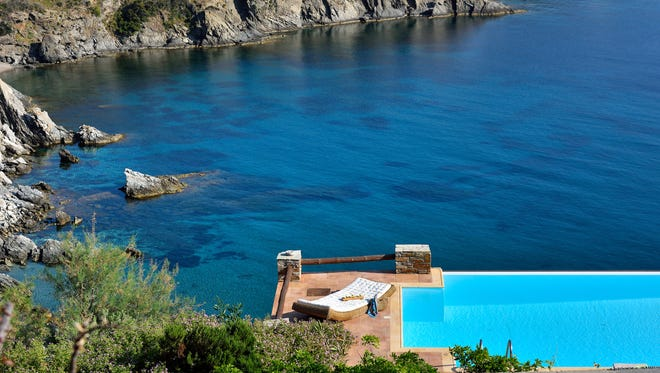 This villas on the Cyclades island of Andros.has panoramic views from the pool.