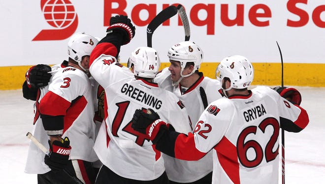 Ottawa Senators right wing Erik Condra (22) celebrates with teammates after his goal against the Montreal Canadiens during the first period at Bell Centre.