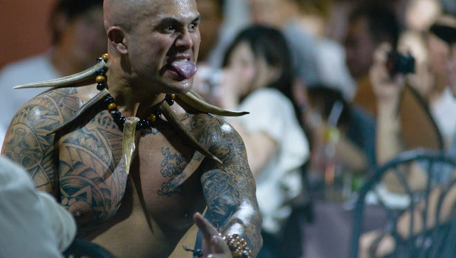 U.S. Navy Hospital Corpsman Sherwin Mora gets in close to the crowd during a Pacific Islander cultural show at Fisheye Marina in Piti, Guam. Mora and his cast mates go into the crowd during the Maori of New Zealand part of their show. The Maori dance, known as haka, is known around the world.