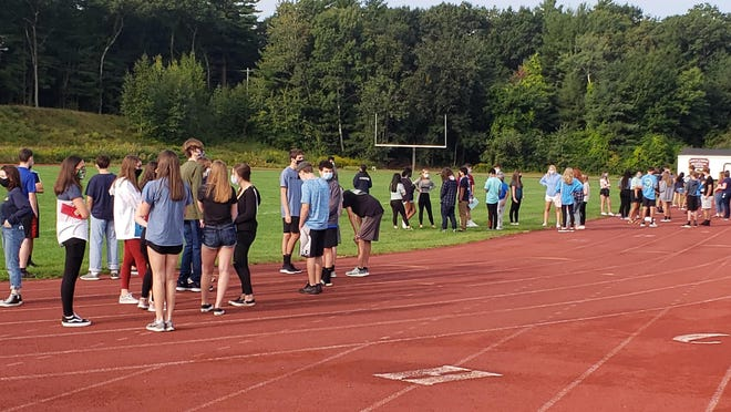 Chelmsford High School freshmen gathered recently for a socially-distanced orientation at the school's outdoor athletic facilities.