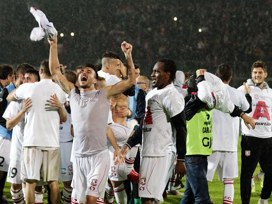 In this picture taken on Tuesday, April 28, 2015 and made available on Wednesday, April 29, 2015, Carpi players celebrate at the end of a Serie B soccer match against Bari at the Sandro Cabassi stadium in Carpi, Italy. The Emilia-Romagna club completed a fairytale-like first promotion to Serie A this week, just five years removed from Italy's fifth division. The Serie B leader, Carpi clinched promotion with four matches to spare following a 0-0 draw at home with Bari on Tuesday. For most of its 106-year history, Carpi was mired in the lowest divisions of Italian football. (Elisabetta Baracchi/ANSA via AP)