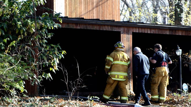 Firefighters re-enter a home on Arrowhead Court in Springfield Township  where the body of a woman was discovered after they responded to a fire.  The cause of death and what started the fire are under investigation, said Springfield Township Fire Chief Robert Leininger.