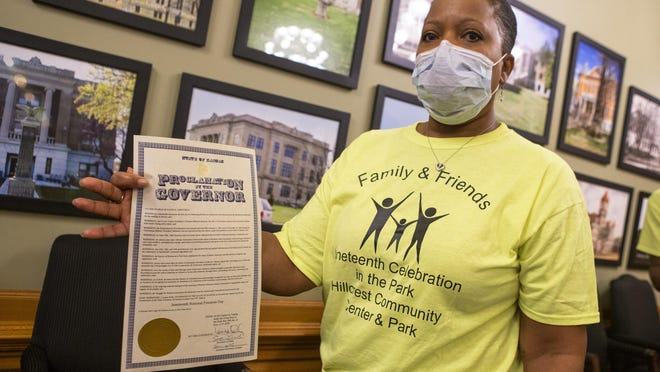 Sherri Camp, with the Topeka Family and Friends Juneteenth Committee, holds the newly signed proclamation by Gov. Laura Kelly marking June 19, 2020, as Juneteenth National Freedom Day.