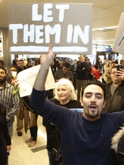 Supporters cheer as an Iranian citizen with a valid U.S. visa arrives at Los Angeles International Airport on Feb. 2.