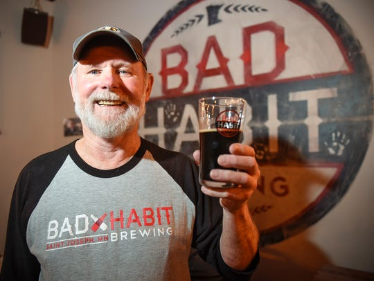 Homebrewer John Ludwig holds a pint of his creation,