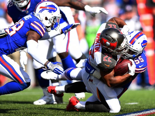 Buffalo Bills defensive end Jerry Hughes (55) tackles Tampa Bay Buccaneers' Doug Martin (22) as teammate E.J. Gaines (28) closes in during the first half of an NFL football game Sunday, Oct. 22, 2017, in Orchard Park, N.Y. (AP Photo/Rich Barnes)