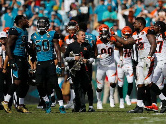 Jacksonville Jaguars defensive end Yannick Ngakoue (91) and Cincinnati Bengals outside linebacker Vontaze Burfict (55) exchange words as benches clear following a fight between Cincinnati Bengals wide receiver A.J. Green (18) and Jacksonville Jaguars cornerback Jalen Ramsey (20) late in the second quarter of the NFL Week 9 game between the Jacksonville Jaguars and the Cincinnati Bengals at EverBank Field in Jacksonville, Fla., on Sunday, Nov. 5, 2017. At halftime the Bengals trailed 10-7 after wide receiver A.J. Green was ejected for throwing a punch.