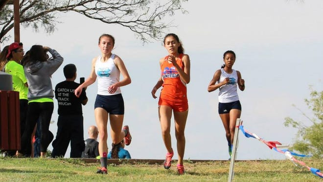 Canutillo High School's Anisa Burciaga, right, returns to the Class 5A state cross country meet in Round Rock.