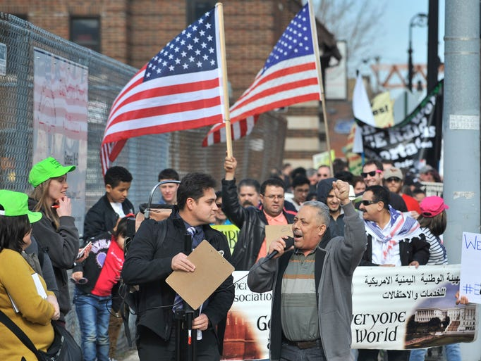 Manuel Sierra, right, leads a chant with Adonis Flores,