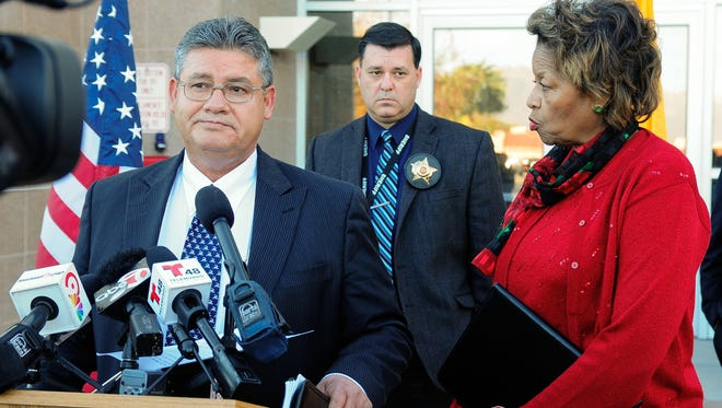 "County Manager Julia Brown interrupts Sheriff Enrique Vigil during his press conference to deliver a restraining order to him on Tuesday, Dec. 8, 2015. The temporary restraining order states, ""Sheriff Vigil is without any legal authority to issue an Executive Order pertaining to the operation of the Doña Ana County Detention Center."""