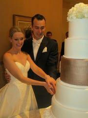 Bride Lila Nelson and groom Tyler Daniel cut the wedding