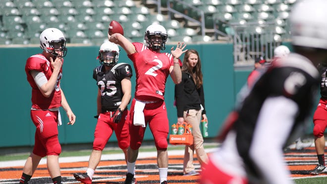 Michael Colosimo (2) looks to pass during drills before a University of Cincinnati intrasquad scrimmage at Paul Brown Stadium on Sunday.