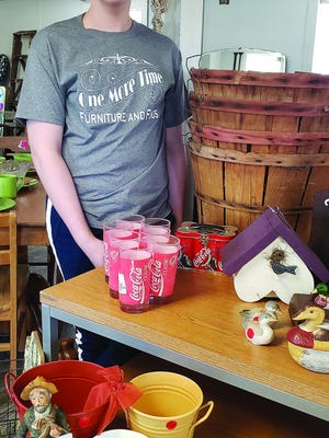 Westyn Clifton displays a variety of merchandise available for sale at One More Time Furniture and Finds, 1115 West Highway 54, which maintains a FaceBook presence with photos. Proprietor is Westyn's mother, Lisa Clifton, former owner-manager of Fabulous Finds in downtown Pratt.