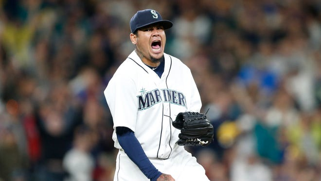 Mariners pitcher Felix Hernandez reacts after recording the final out of the seventh inning against the Rangers at Safeco Field.