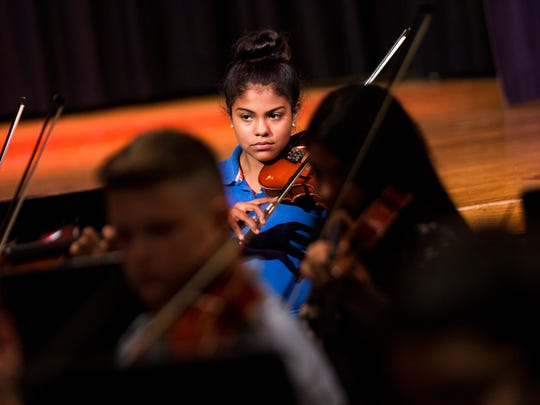 Yulissa Sanchez, 12, plays the viola during beginning orchestra rehearsal at Pine Ridge Middle School on Monday, May 1, 2017. Music teacher Nanette Grant used a Champions for Learning grant to bring New York composer Lorie Gruneisen to the school and compose a piece for each of the school's three string classes to play during their spring concert performance Wednesday.