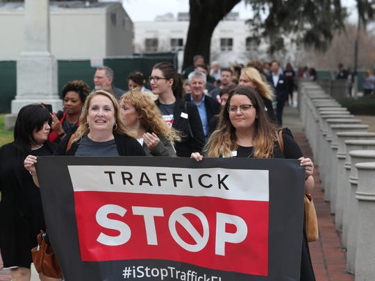 A group of nearly a hundred people march from the Civic Center to the Historic Capitol in an effort to raise awareness against human trafficking Thursday, Jan. 11, 2018.