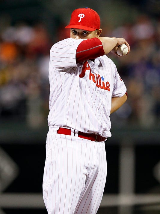 Philadelphia Phillies pitcher David  Hernandez wipes his face after the second of two back-to-back home runs by the New York Mets during the eighth  inning of a baseball game Monday, April 18, 2016, in Philadelphia. The Mets won 5-2. (AP Photo/Tom Mihalek)