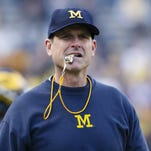 Michigan hires father of four-star QB recruit