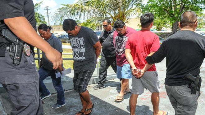 Guam Police Department officers escort multiple suspects in and out of the Hagåtña precinct on Wednesday, April 6. They were arrested on suspicion of assault, rioting and disorderly conduct following a video allegedly capturing a brawl at the Dededo cockfighting pit that went viral recently.