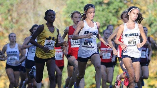 Corinne Barney (5078) and other runners are shown at the start of the Freedom race in Mahwah.  Barney came in third place, Tuesday, October 10, 2017.