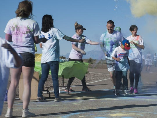 The Youth and Teen Center hosted the Art Blast color run 5K and the America's Armed Forces Kids fun run at Holloman Air Force Base, N.M on May 20, 2017. During the run, volunteers set up tables along the track with various colored paint powder to toss at the runners transforming their fresh white shirts into a colorful canvas.
