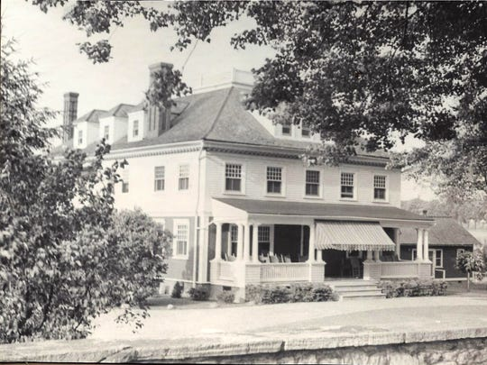 The Quentin Riding Club clubhouse in the 1940s. It was once the home of Senator William C. Freeman Jr. The Quentin Riding Club owes $100,000 in back taxes to the county and will be put up for auction in September if the club fails to pay its debt.