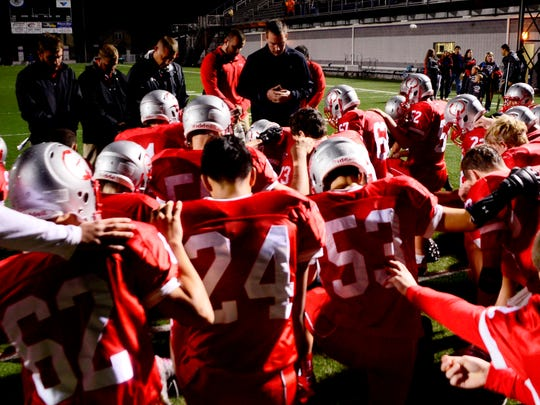 The St. Joseph Central Catholic football team says a prayer following its 41-18 loss to Lakota Saturday.