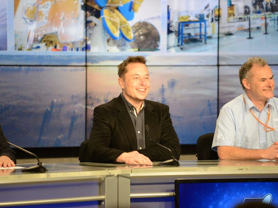 At a press conference Thursday at Kennedy Space Center, SpaceX CEO Elon Musk, left, and SES Chief Technology Officer Martin Halliwell celebrated the successful 6:27 p.m. launch of the SES-10 satellite by a previously flown Falcon 9 rocket booster from KSC's pad 39A.