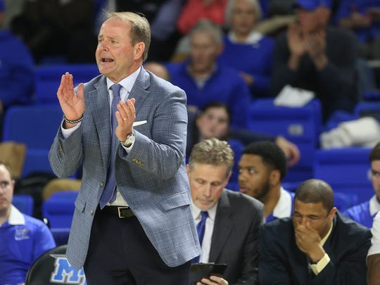 MTSU's head coach Kermit Davis cheers on the sidelines