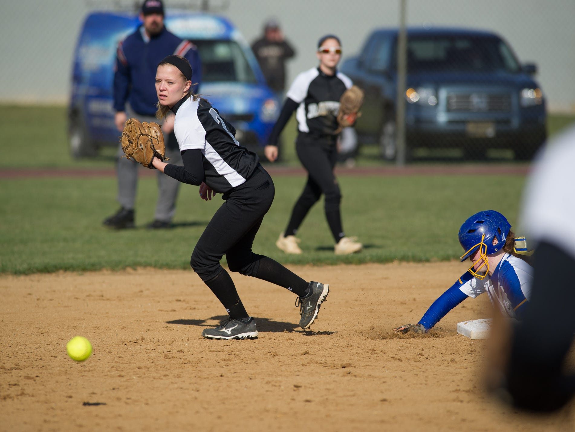 Sussex Tech's Nicole Hovatter (2) misses a catch letting Sussex Central's Mariah Rogers (22) slide safety into second base.