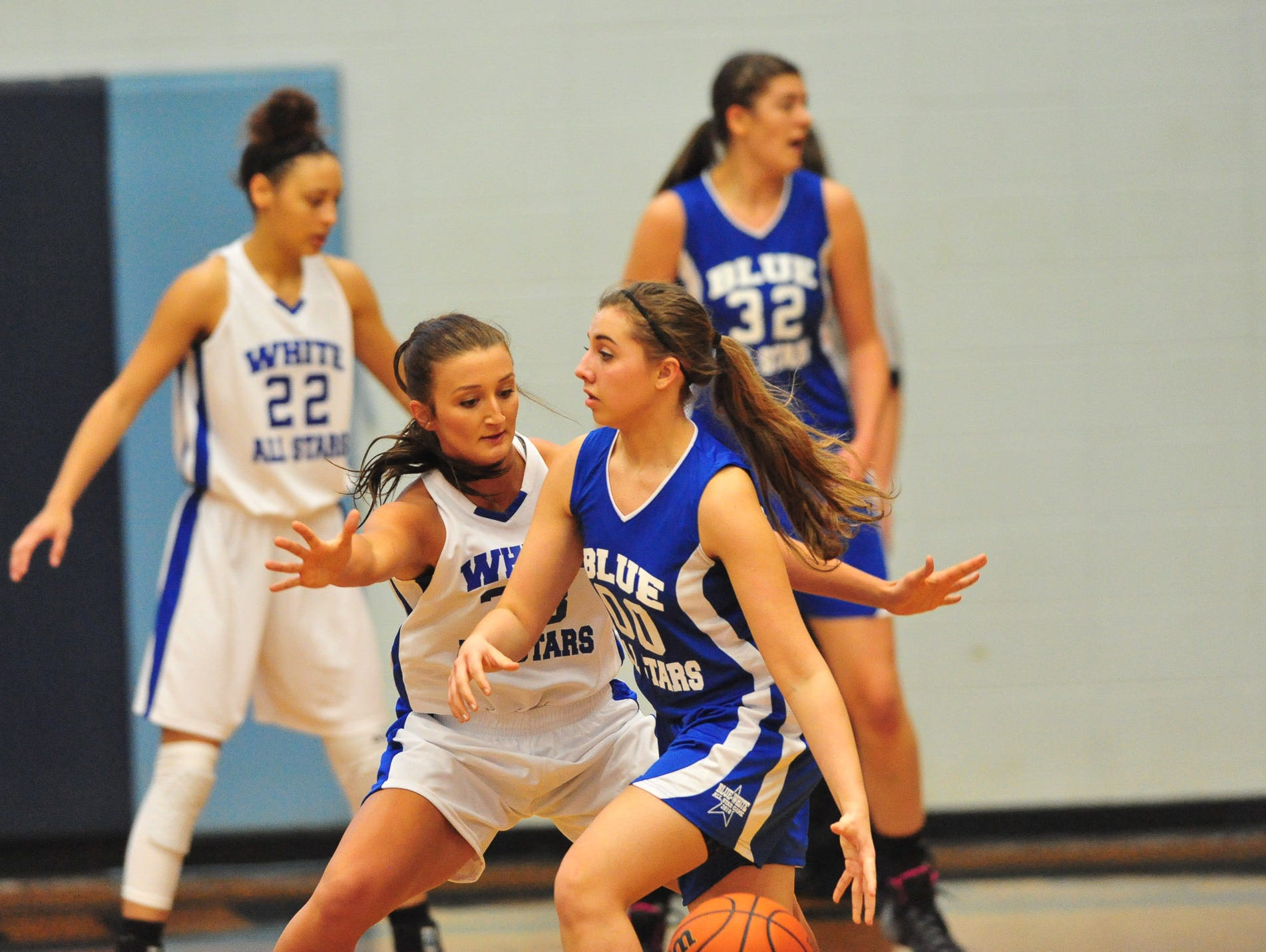 Pisgah's Brooklyn Allen guards Owen's Taylor Lovci during the March 19 Blue-White All-Star girls basketball game at Enka. Allen is the Citizen-Times All-WNC Girls Basketball Player of the Year.