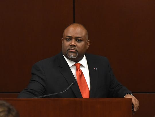 Assemblyman Jason Frierson sits in the Assembly Chambers