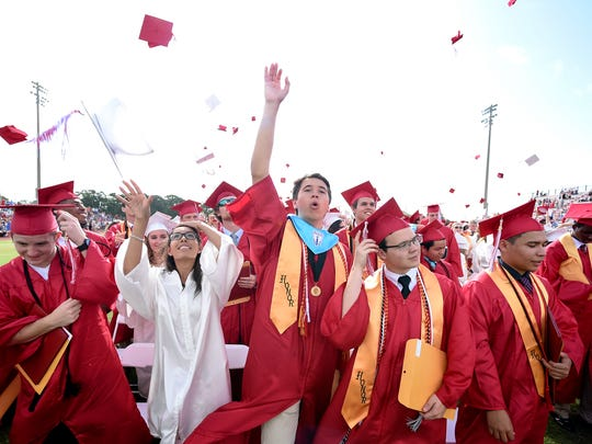 Vero Beach graduates (left to right) Clay Aldhizer, Lizmar Alers, Wesley Alexander, Brandon Alfaro, and Diego Alvarado celebrate Saturday, May 20, 2017, at the end of the Vero Beach High School commencement ceremony at Vero Beach High School. The district is expecting to celebrate 2020 graduates in July, Superintendent David Moore said.
